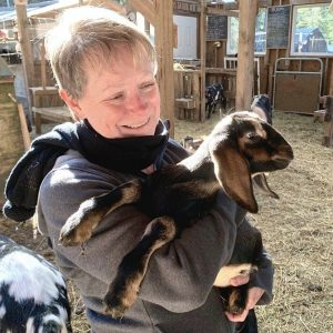 Janice Ammundsen cuddles one the baby goats on her Quadra Island farm.